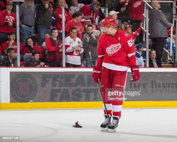 Red octopus getty images danny dekeyser of the detroit red wings skates by an octopus that was tossed to the voltagebd Images