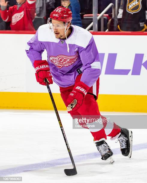 Danny DeKeyser of the Detroit Red Wings skates in warm-ups with his custom Hockey Fights Cancer jersey prior to an NHL game against the Arizona...