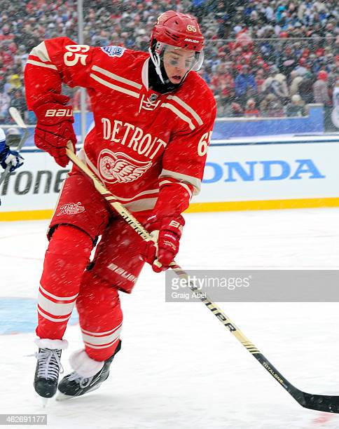 Danny DeKeyser of the Detroit Red Wings skates up the ice during NHL game action against the Toronto Maple Leafs during the 2014 Bridgestone NHL...