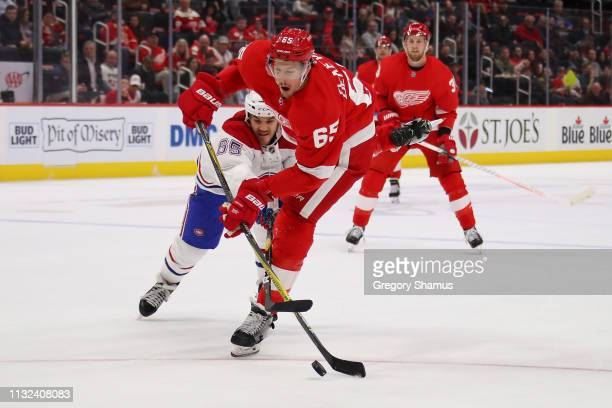 Danny DeKeyser of the Detroit Red Wings takes a second period shot next to Andrew Shaw of the Montreal Canadiens at Little Caesars Arena on February...