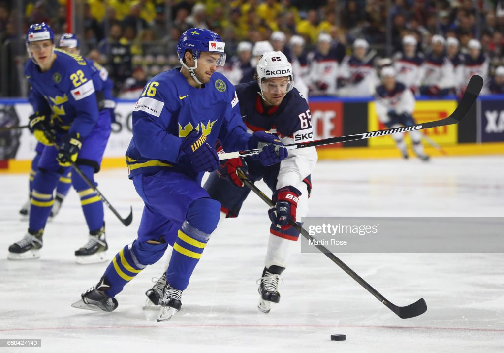 Danny Dekeyser of USA challenges Marcus Kruger of Sweden during the 2017 IIHF Ice Hockey World Championship game between USA and Sweden at Lanxess Arena on May 8, 2017 in Cologne, Germany.