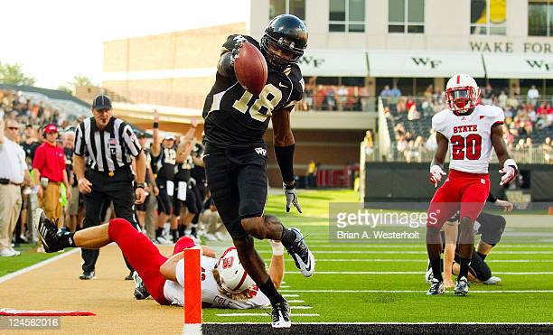 Danny Dembry of the Wake Forest Demon Deacons extends the ball over the goaline as he scores on a 10-yard touchdown run against the North Carolina...