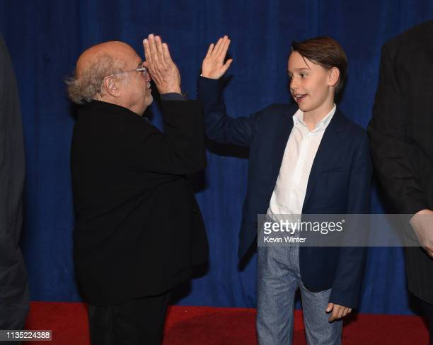 Danny DeVito and Finley Hobbins attend the premiere of Disney's Dumbo at El Capitan Theatre on March 11 2019 in Los Angeles California