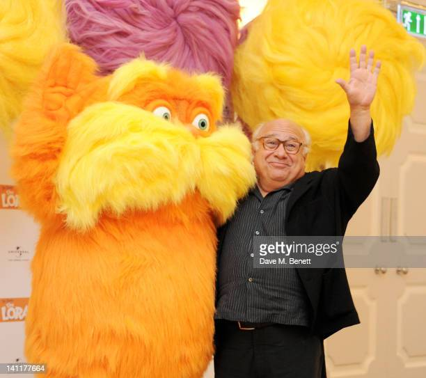 Danny DeVito poses with the Lorax as part of a UK photocall to celebrate the huge success of his new film 'The Lorax' on March 12 2012 in London...