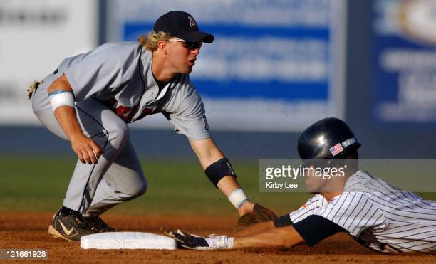 Danny Dorn of Cal State Fullerton slides beneath tag of Arizona second baseman Brad Boyer on a second-inning double during the Titans' 6-3 victory...