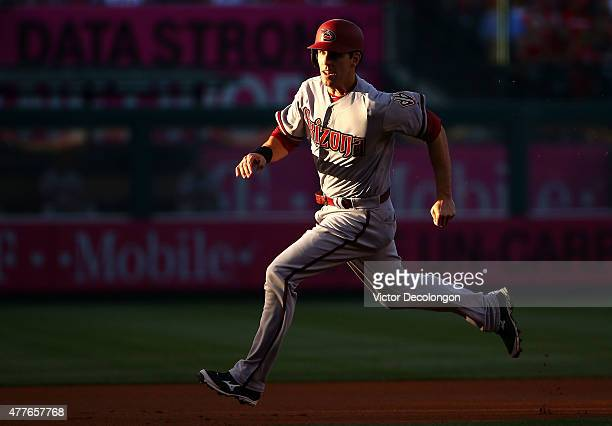 Danny Dorn of the Arizona Diamondbacks runs to third from second on a single by David Peralta of the Arizona Diamondbacks in the first inning during...
