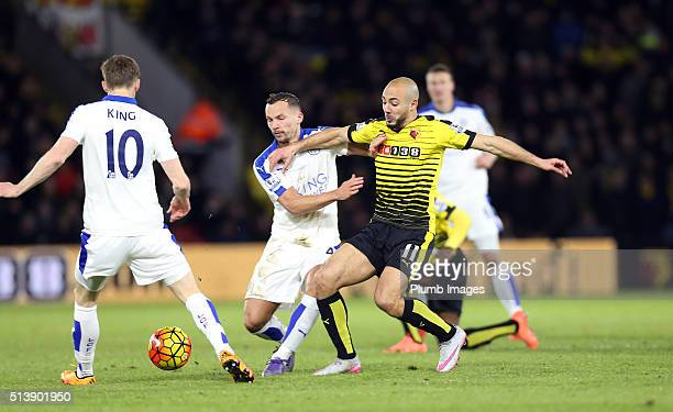 Danny Drinkwater and Andy King of Leicester City in action with Nordin Amrabat of Watford during the first half of the Premier League match between...