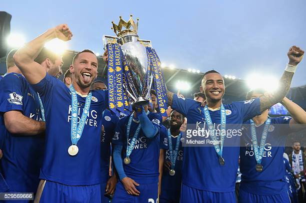 Danny Drinkwater and Danny Simpson of Leicester City poses with the Premier League Trophy as players and staffs celebrate the season champion after...
