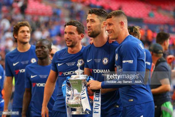 Danny Drinkwater Gary Cahill and Ross Barkley of Chelsea pose with the trophy at the end of the Emirates FA Cup Final between Chelsea and Manchester...