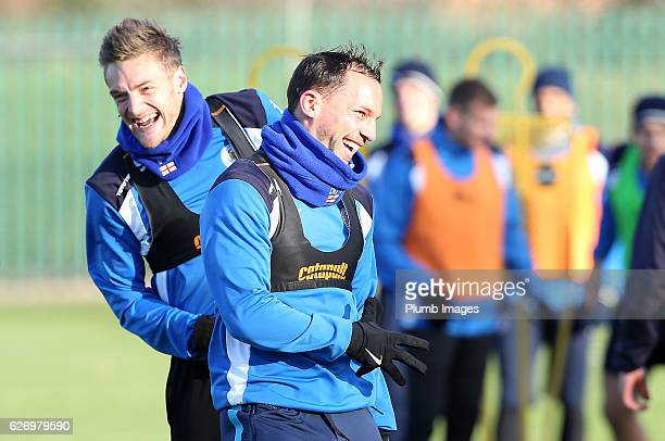 Danny Drinkwater jokes with Jamie Vardy during a Leicester City training session at Belvoir Drive Training Complex on December 01 , 2016 in...