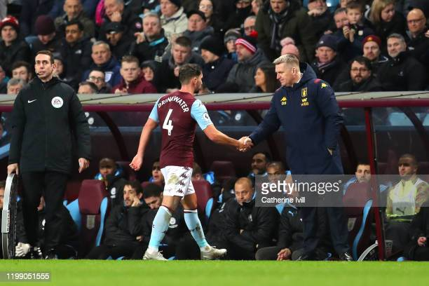 Danny Drinkwater of Aston Villa shakes hands with Dean Smith Manager of Aston Villa as he leaves the pitch during the Premier League match between...