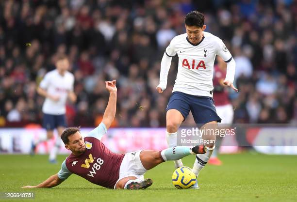 Danny Drinkwater of Aston Villa slides in to tackle HeungMin Son of Tottenham Hotspur during the Premier League match between Aston Villa and...