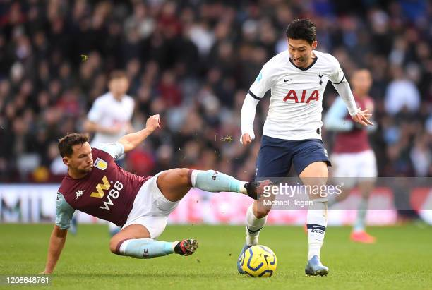 Danny Drinkwater of Aston Villa slides in to tackle Heung-Min Son of Tottenham Hotspur during the Premier League match between Aston Villa and...