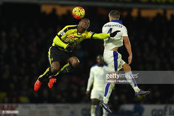 Danny Drinkwater of Leicester City and Obbi Oulare of Watford compete for the ball during the Barclays Premier League match between Watford and...