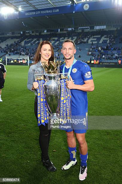 Danny Drinkwater of Leicester City celebrates with the Premier League trophy after the Barclays Premier League match between Leicester City and...