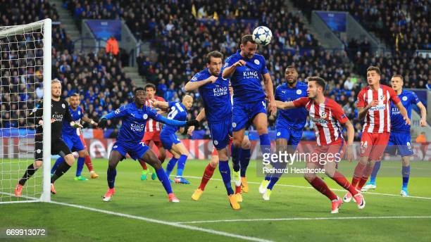 Danny Drinkwater of Leicester City heads clear during the UEFA Champions League Quarter Final second leg match between Leicester City and Club...