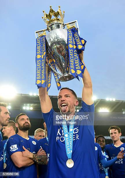 Danny Drinkwater of Leicester City lifts the Premier League Trophy as players and staffs celebrate the season champion after the Barclays Premier...