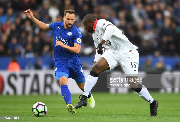 Danny Drinkwater of Leicester City puts pressure on Stefano Okaka of Watford during the Premier League match between Leicester City and Watford at...