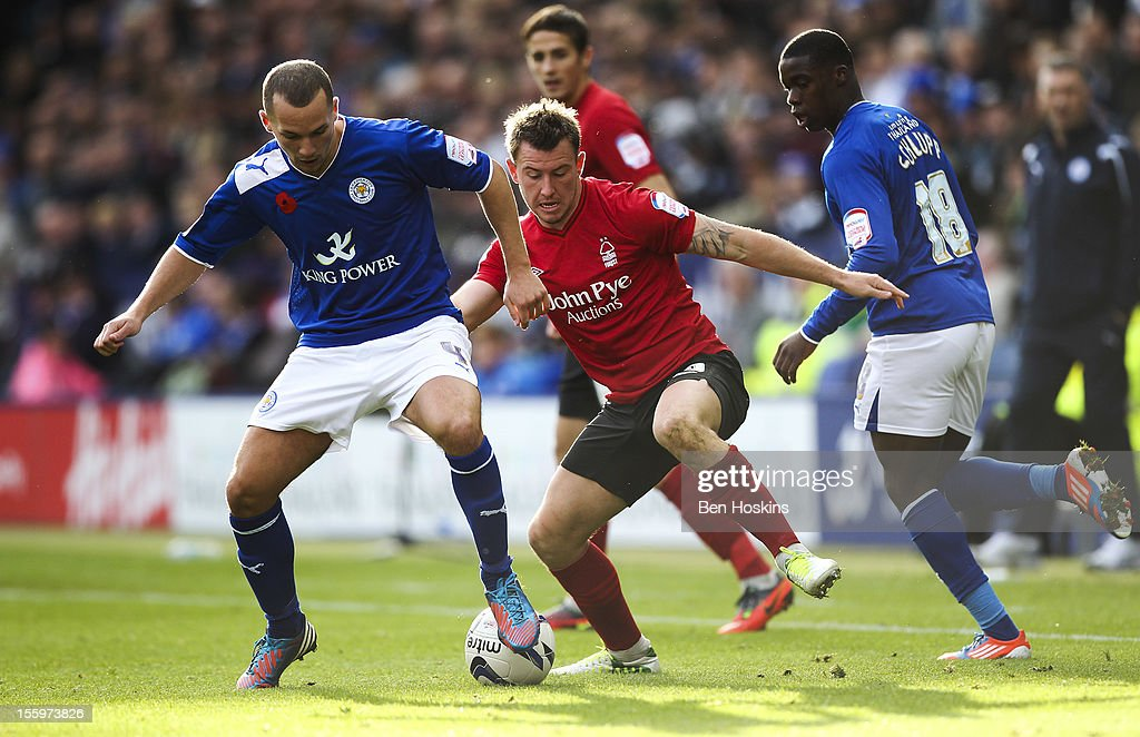 Danny Drinkwater of Leicester holds off the challenge of Simon Cox of Nottingham during the npower Championship match between Leicester City and Nottingham Forest at the King Power Stadium on November 10, 2012 in Leicester, England.