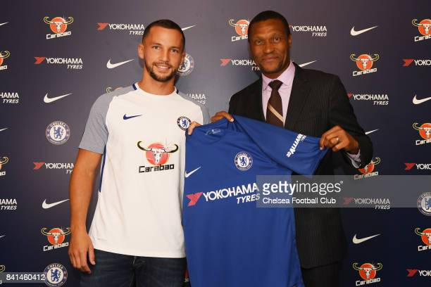 Danny Drinkwater poses with technical director Michael Emenalo as he is unveiled as a new signing for Chelsea FC on August 31 2017 in Cobham England