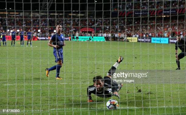 Danny Drirnkwater of Leicester City scores from the penalty spot during the Premier League Asia Trophy match between Leicester City and West Bromwich...