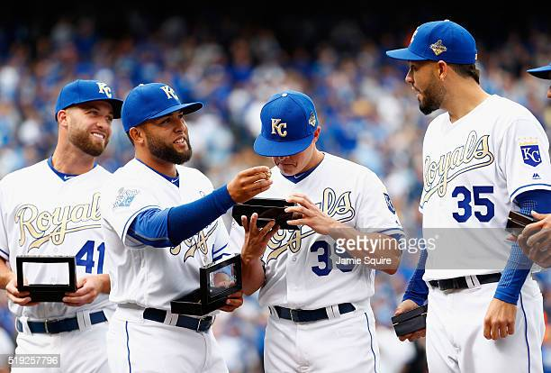 Danny Duffy Kelvin Herrera Kris Medlen and Eric Hosmer of the Kansas City Royals inspect their 2015 World Series Championship rings during a ring...