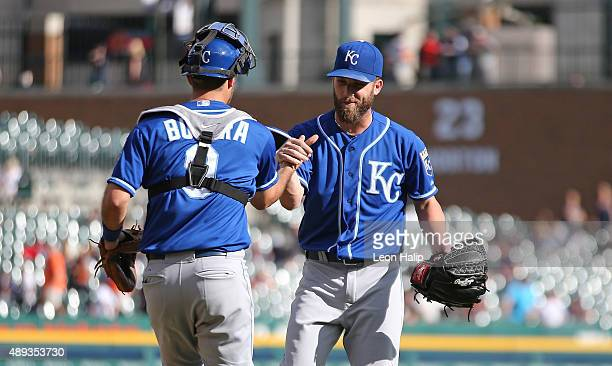 Danny Duffy of the Kansas City Royals celebrates a win over the Detroit Tigers with catcher Drew Butera on September 20 2015 at Comerica Park in...