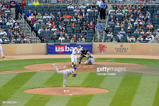 Danny Duffy of the Kansas City Royals delivers a pitch to Chris Parmelee of the Minnesota Twins as Salvador Perez of the Kansas City Royals catches...