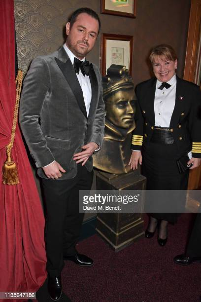 Danny Dyer and Cunard Captain Inger Klein Thorhauge attend The Olivier Awards 2019 with Mastercard at The Royal Albert Hall on April 7 2019 in London...