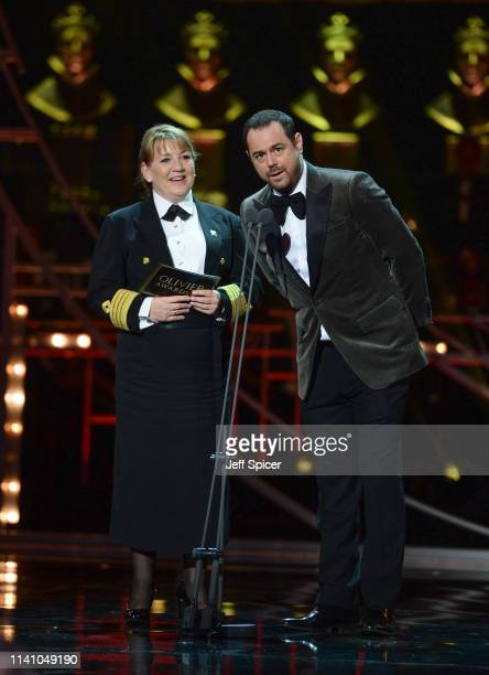 Danny Dyer and Cunard Captain Inger Klein Thorhauge on stage during The Olivier Awards 2019 with Mastercard at the Royal Albert Hall on April 07 2019...