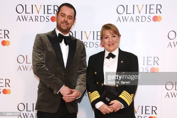 Danny Dyer and Cunard Captain Inger Klein Thorhauge pose in the press room at The Olivier Awards 2019 with Mastercard at The Royal Albert Hall on...