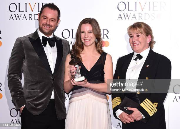 Danny Dyer Rebecca Frecknall and Captiain Inger Klein Thorhauge with the award for Cunard best revivial during The Olivier Awards with Mastercard at...