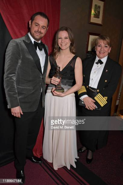 Danny Dyer Rebecca Frecknall winner of Best Revival for Summer And Smoke and Cunard Captain Inger Klein Thorhauge attend The Olivier Awards 2019 with...