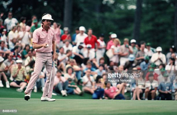 Danny Edwards concentrates on the green in front of a large gallery during the 1986 Masters Tournament at Augusta National Golf Club in April 1986 in...