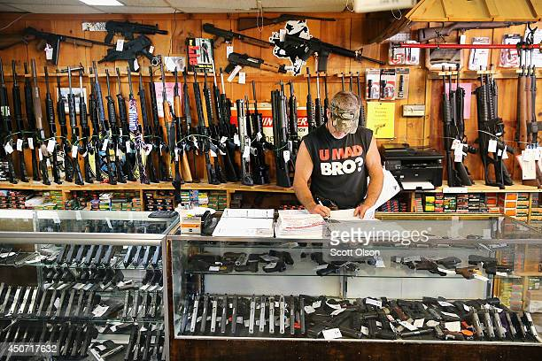 Danny Egan fills out mandatory gun paperwork Freddie Bear Sports on June 16 2014 in Tinley Park Illinois In a 54 decision the Supreme Court ruled...