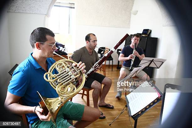 Danny Erdman clarinet Nadav Cohen bassoon and Itamar Leshem horn members of the Tel Aviv Wind Quintet play in rehearsal at the Jerusalem Music Center...