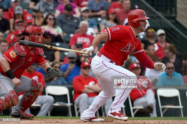 Danny Espinosa of the Los Angeles Angels of Anaheim bats against the Cincinnati Reds during a spring training game at Tempe Diablo Stadium on March 5...