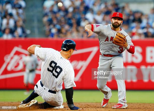 Danny Espinosa of the Los Angeles Angels of Anaheim completes a third inning double play after forcing out Aaron Judge of the New York Yankees at...