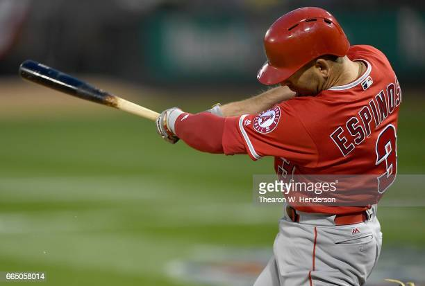 Danny Espinosa of the Los Angeles Angels of Anaheim hits a tworun rbi single against the Oakland Athletics in the top of the second inning at the...