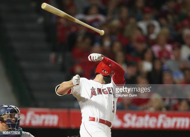 Danny Espinosa of the Los Angeles Angels of Anaheim loses his bat as he swings and misses in the seventh inning against the Seattle Mariners at Angel...