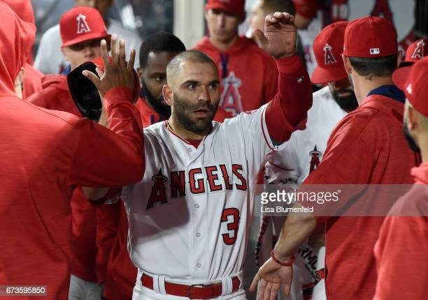 Danny Espinosa of the Los Angeles Angels of Anaheim returns to the dugout after scoring in the second inning against the Oakland Athletics at Angel...