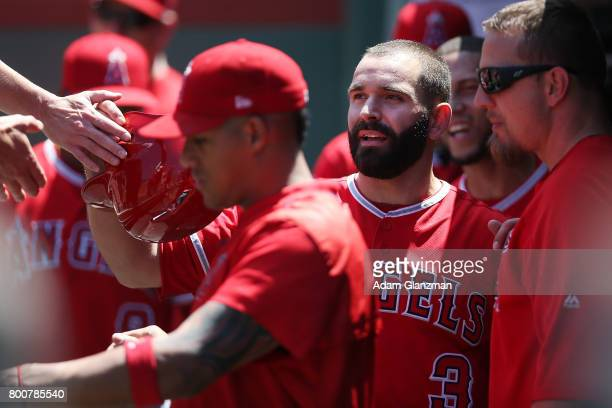Danny Espinosa of the Los Angeles Angels of Anaheim returns to the dugout after scoring in the second inning of a game against the Boston Red Sox at...