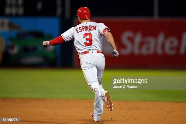 Danny Espinosa of the Los Angeles Angels of Anaheim rounds the bases after hitting a three run home run off of Ryan Dull of the Oakland Athletics...