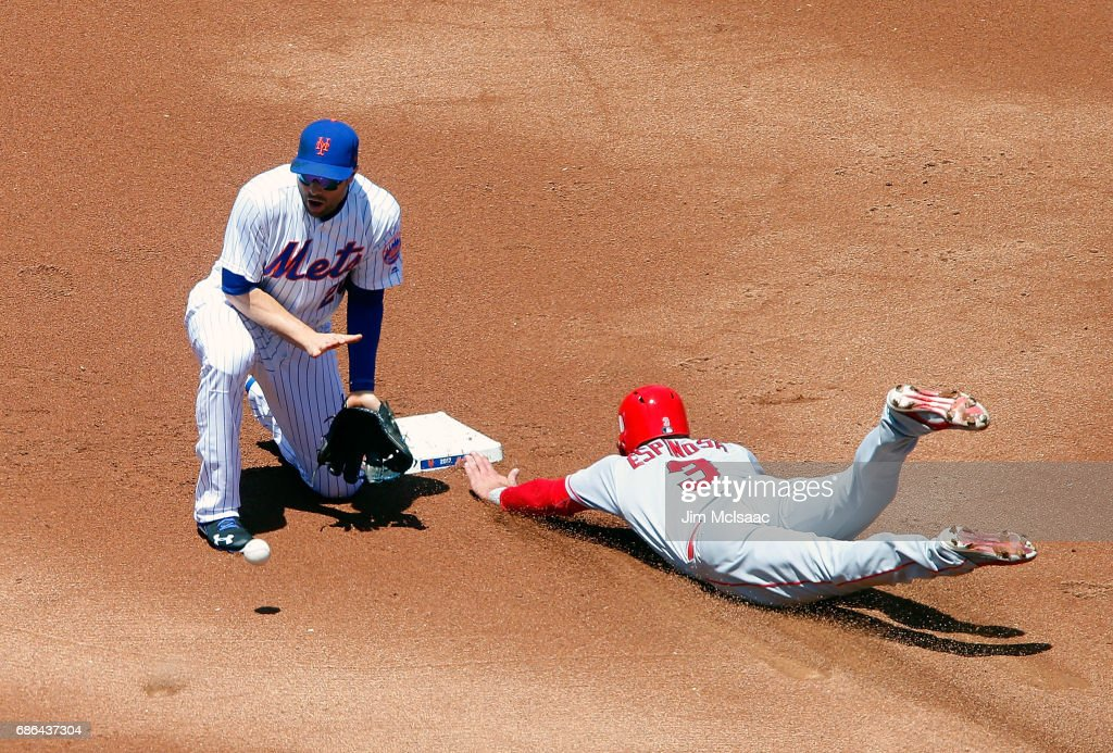 Danny Espinosa #3 of the Los Angeles Angels of Anaheim steals second base in the first inning ahead of the throw to Neil Walker #20 of the New York Mets at Citi Field on May 21, 2017 in the Flushing neighborhood of the Queens borough of New York City.