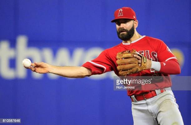 Danny Espinosa of the Los Angeles Angels of Anaheim throws out Nomar Mazara of the Texas Rangers during the eighth inning at Globe Life Park in...