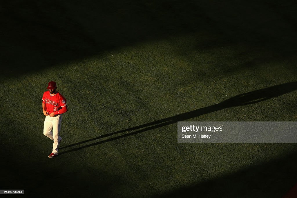 Danny Espinosa #3 of the Los Angeles Angels of Anaheim walks in the outfield prior to a game against the Kansas City Royals at Angel Stadium of Anaheim on June 15, 2017 in Anaheim, California.