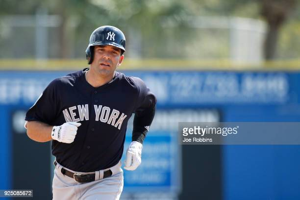 Danny Espinosa of the New York Yankees rounds the bases after hitting a solo home run in the fourth inning of a Grapefruit League spring training...