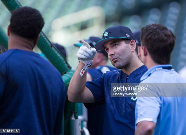 Danny Espinosa of the Seattle Mariners center talks with his new teammates during batting practice before the game against the Boston Red Sox at...