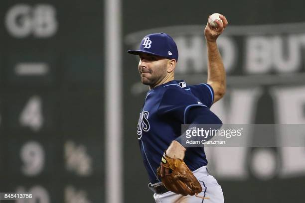 Danny Espinosa of the Tampa Bay Rays throws to first base during a game against the Boston Red Sox at Fenway Park on September 9 2017 in Boston...