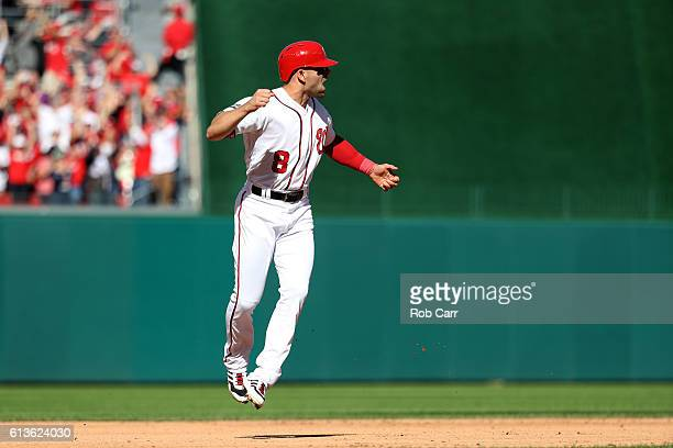 Danny Espinosa of the Washington Nationals celebrates after scoring off of a three run home run hit by teammate Jose Lobaton against the Los Angeles...